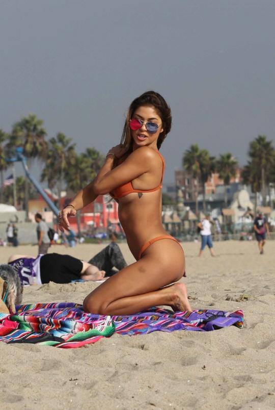 Janine Taking Off Orange Bikini On The Beach Yespornplease 1